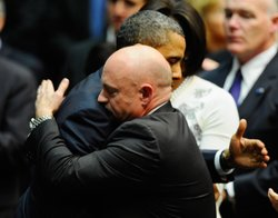 President Barack Obama hugs NASA astronaut Mark Kelly, husband of Rep. Gabrielle Giffords (D-AZ), during a service in Tucson, Ariz., Wednesday.