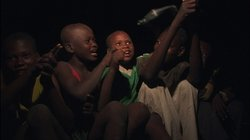 Street kids singing at night in Haiti.