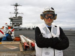 David Pogue on the flight deck of a U.S. naval aircraft carrier