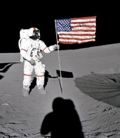 "Astronaut Alan B. Shepard Jr., Apollo 14 Commander, stands by the U.S. flag on the lunar Fra Mauro Highlands during the early moments of the first extravehicular activity (EVA-1) of the mission. Shadows of the Lunar Module ""Antares"", astronaut Edgar D. Mitchell, Lunar Module pilot, and the erectable S-band Antenna surround the scene of the third American flag planting to be performed on the lunar surface."