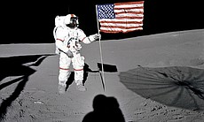 Astronaut Alan B. Shepard Jr., Apollo 14 Commander, stands by the U.S. flag o...