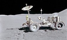 The Lunar Roving Vehicle is photographed alone against the lunar background during the Apollo 15 lunar surface extravehicular activity (EVA) at the Hadley-Apennine landing site. This view is looking north. The west edge of Mount Hadley is at the upper right edge of the picture. Mount Hadley is at the upper right edge of the picture. It rises approximately 4,500 meters (about 14,765 feet) above the plain. The most distant lunar feature visible is approximatley 25 kilometers (about 15.5 statute miles) away.