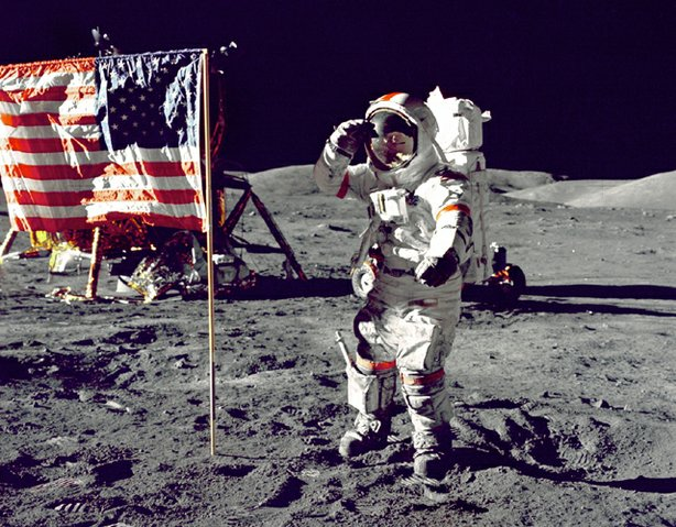 "Eugene A. Cernan, Commander, Apollo 17 salutes the flag on the lunar surface during extravehicular activity (EVA) on NASA's final lunar landing mission. The Lunar Module ""Challenger"" is in the left background behind the flag and the Lunar Roving Vehicle (LRV) also in background behind him. While astronauts Cernan and Schmitt descended in the Challenger to explore the Taurus-Littrow region of the Moon, astronaut Ronald E. Evans, Command Module pilot, remained with the Command/Service Module (CSM) ""America"" in lunar-orbit."