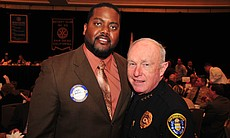 SDG&E lineman Daryl Hollins, pictured with Chief of Police William Landsdowne...