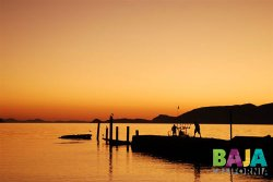 Promotional photo of a sunset in Bahia de los Angeles, by Baja California's state tourism agency.