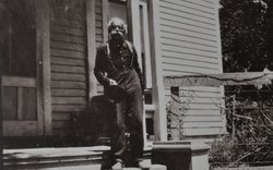 Black pioneer, Albert Robinson, in front of the Hotel Robinson, now the Histo...