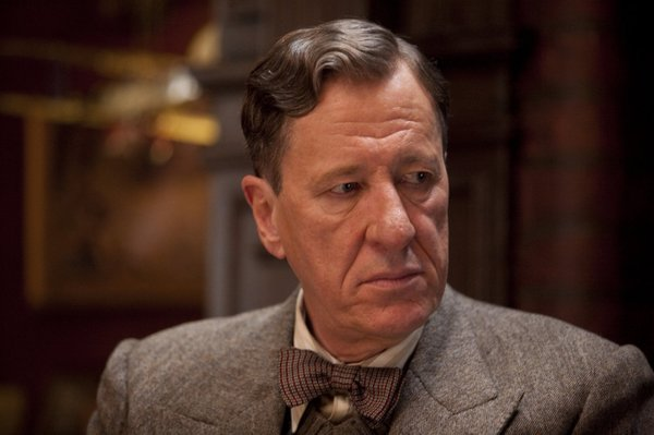 "Geoffrey Rush as Lionel Logue in ""The King's Speech."""