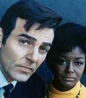 "Mike Connors played the lead in the innovate crime drama ""Mannix"" for an 8-year run. Pictured here with his co-star Gail Fisher."