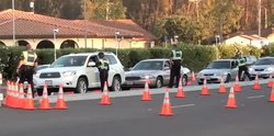This image captured from a Youtube video shows Police conducting a checkpoint...