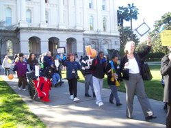 Advocates rallied on behalf of adult health care at the state's capitol today.