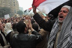 Anti-government demonstrators chant slogans for freedom in Tahrir Square on F...