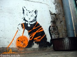 Banksy has used cats before in his street art. Is that a clue?