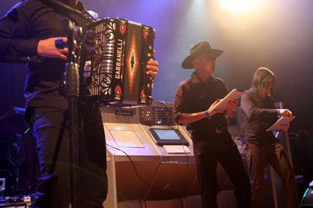 Nortec artists Bostich and Fussible (right) perform with an accordionist at the House of Blues in San Diego on October 13, 2010.