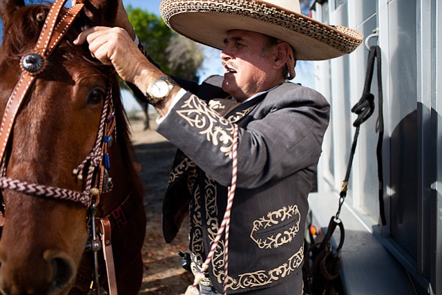 Filemon Jara Sr. of San Ysidro gets his horse ready for a Sunday ch... ()