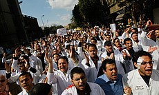 Anti-government medical school students and professors march though a downtown street February 10, 2011 in Cairo, Egypt.