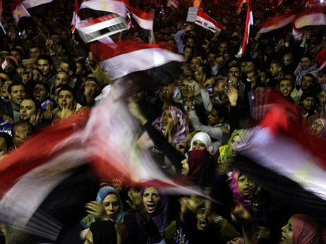 Tens of thousands of anti-government protesters chant slogans and wave the Egyptian flag in Cairo's Tahrir Square on Thursday.