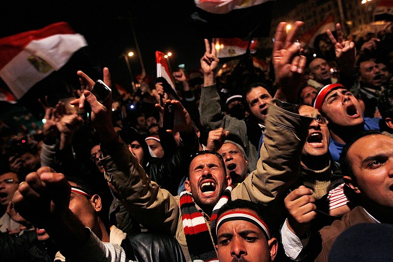 Anti-government protesters rally after a speech by Egyptian President Hosni M...