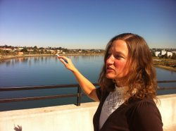 San Diego Coastkeeper Staff Scientist Jen Kovecses points toward an area in P...