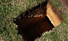 A hole was dug so that Cissy Raymond's ashes co...