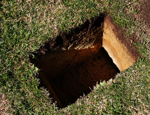 A hole was dug so that Cissy Raymond's ashes could be placed in the same burial plot with her husband Raymond Chandler's remains.