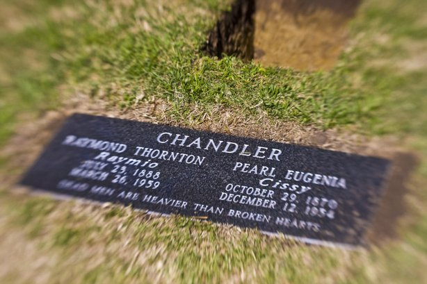 "The new grave marker for the Chandler gravesite. It includes the names of both Raymond and Cissy, along with the line from the Chandler-penned novel ""The Big Sleep"": ""Dead men are heavier than broken hearts."""