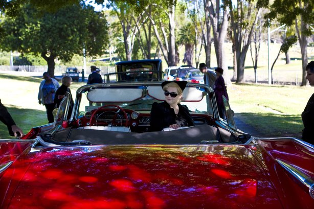 A parade of classic, antique cars drove Cissy Chandler's ashes from the Mausoleum to the Chandler grave.