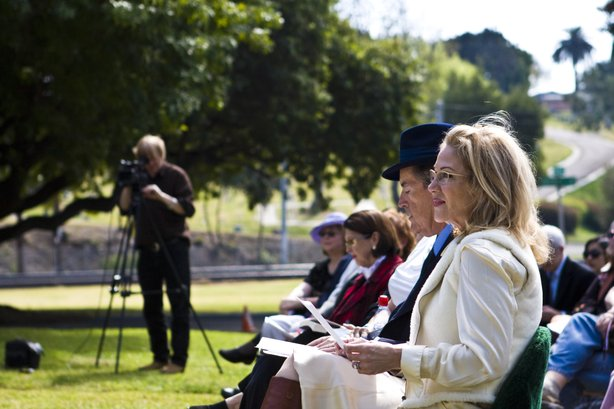 Aissa Wayne, daughter of film star John Wayne, and actor Powers Booth watch the ceremony.