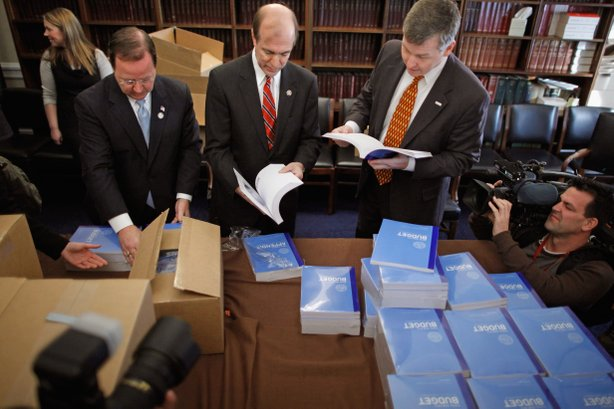 House Budget Committee members (L-R) Rep. Bill Flores (R-TX), Rep. Scott Garrett (R-NJ) and Rep. Rob Woodall (R-GA) unload boxes of President Barack Obama's proposed FY2012 federal budget in the Cannon House Office Building February 14, 2011 in Washington, DC.