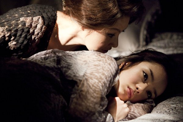 "Park Ji-young as th emother and Seo Woo as the wife in ""The Housemaid."""