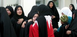 Women in Manama, Bahrain, mourn over the dead and wounded from Thursday morni...