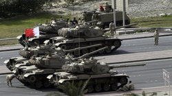 Bahraini army tanks take position near Pearl Square in Manama on Thursday aft...