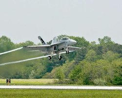 An F/A-18 Super Hornet strike fighter jet, powered by a 50/50 biofuel blend flies out of the Navy's Patuxent River location on Earth Day, April 22, 2010.