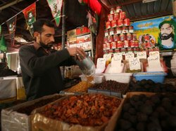 An Iraqi shop owner sells groceries in Baghdad. World Bank President Robert Z...