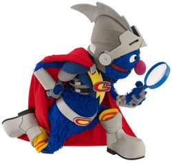 Super Grover uses a magnifying glass to investigate.