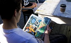 "Kyle Boatwright, a.k.a Sain, looks through ""Subway Art"", a 1980's bible for aspiring graffiti artists."
