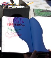 Students practice their tag over and over again by passing down their sketchbooks and comparing each other's styles.