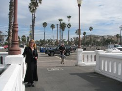 Oceanside Redevelopment Manager, Kathy Baker, stands at the foot of the Oceanside Pier by the empty lot where the city has long planned a hotel resort. Feb 15th 2011