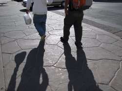 Two migrant agricultural workers head back home to Mexicali after working in the fields in the Imperial Valley.