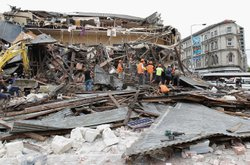 Rescuers search for survivors in a collapsed building in Manchester Street on...