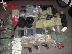 Weapons, drugs and cash seized by federal agents in San Diego.
