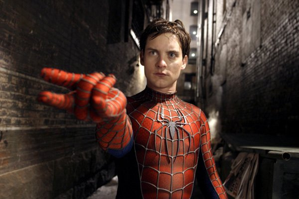 "Tobey Maguire spinning a web as Spidey in ""Spider-Man 2."""