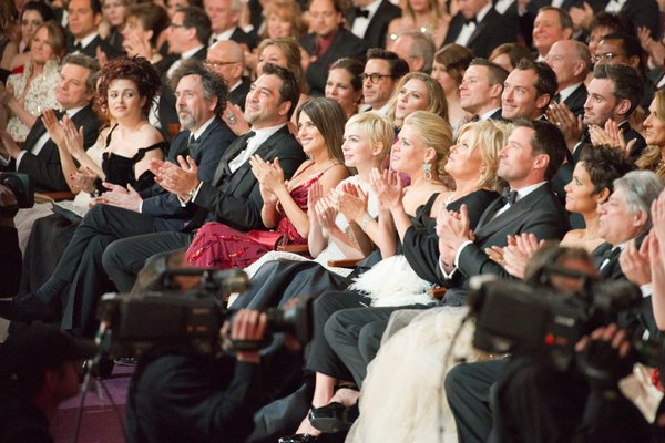 The nominees in the audience politely applauding.