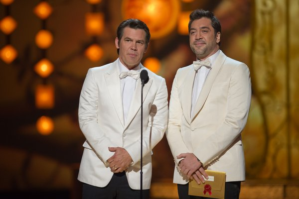 Presenters Josh Brolin and Javier Bardem in spiffy white tux jackets.