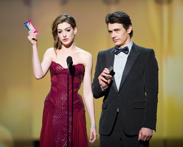 Anne Hathaway and James Franco. She had so many dress changes that the cost of her gowns probably equalled the GNP of a small country.