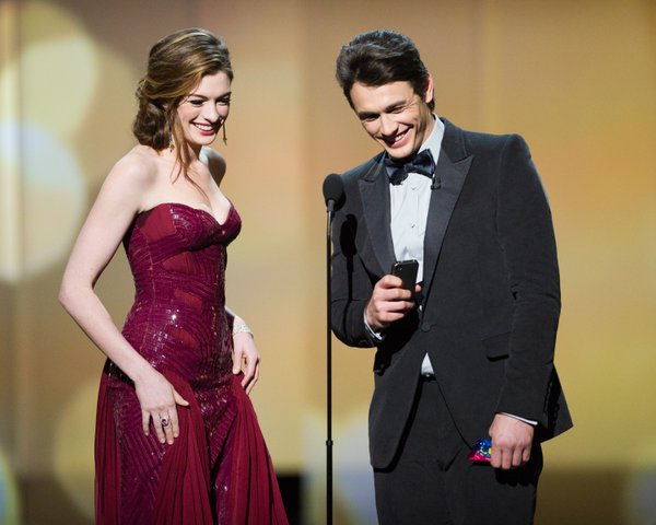 """Oh this old thing..."" Anne Hathaway and James Franco went through numerous costume changes during the 83rd Academy Awards telecast."