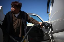 A man pumps gas into his truck at a Flyer's gas station on February 25, 2011 ...