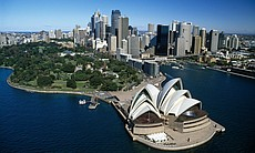 The Sydney Opera House, perched overlooking scenic and iconic Sydney Harbour.