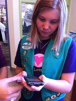 Angela Rosser uses mobile device to charge for Girl Scout Cookies in San Dieg...