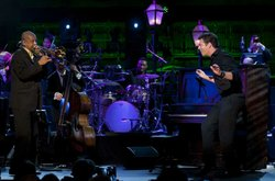Harry Connick Jr. is backed by a cadre of top flight musicians, including tro...