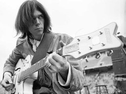 Neil Young performing as part of Crosby, Stills, Nash & Young, Balboa Stadium, San Diego, Calif., December 21, 1969.